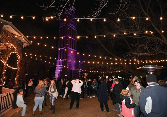 JON C. LAKEY / SALISBURY POST Revelers gather at the Historic Belltower in Downtown Salisbury to ring in the New Year of 2018.  Sunday, December 31, 2018, in Salisbury, N.C.